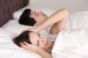 Lady-struggling-to-sleep-due-to-sleep-apnea