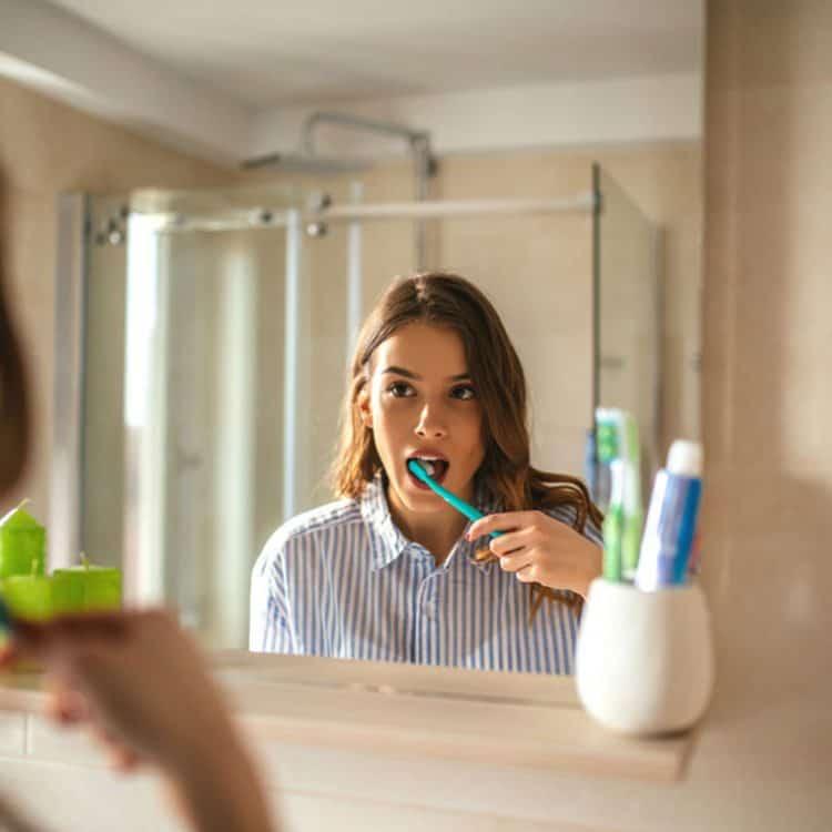 Lady-with-toothbrush-brushing-teeth